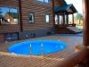 пластиковый бассейн d=5м обрамленный террасным покрытием